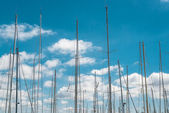 Ship masts over blue sky background — Stock Photo