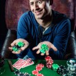Stock Photo: Poker player holding poker chips