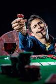 Poker player holding poker chip — Стоковое фото