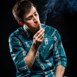 Young man smoking cigarette — Stock Photo #30511199