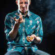 Stock Photo: Young man smoking cigarette