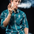 Young man smoking cigarette — Stock Photo #30511239