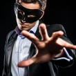 Elegant man wearing black mask posing indoors — Stock Photo