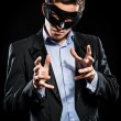Elegant man wearing black mask posing indoors — Stock Photo #30511261