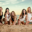 Five sexy ladies on the beach — Stock Photo