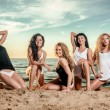 Five sexy ladies posing on the beach — Stock Photo
