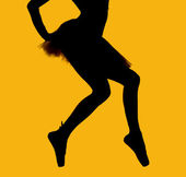 Black silhouette of ballerina isolated over yellow background — Stock Photo