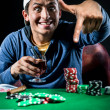 Stock Photo: Cheerful poker player