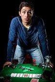 Young gambler indoors — Stock Photo