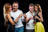 Cheerful group of young people with glasses of champagne — Foto de Stock