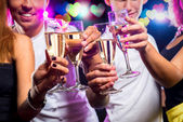 Group of people with glasses of sparkling champagne — Stock Photo