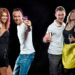 Cheerful group of young people with glasses of champagne — Stock Photo