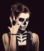 Woman with skeleton face art over black background — Stock Photo