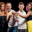 Group of young people with glasses of sparkling champagne — Stock Photo