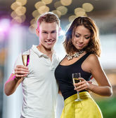 Couple with glasses of champagne — Stock Photo