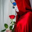 Day of the dead girl with sugar skull makeup holding red rose — Foto Stock #34292149