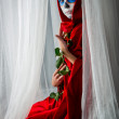 Day of the dead girl with sugar skull makeup holding red rose — Foto Stock #34292191
