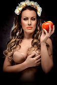 Beautiful woman with red apple, conceptual photo — Stock Photo