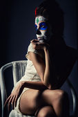 Day of the dead girl with sugar skull make-up — Stockfoto