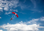 Parachutist over cloudy sky background — Stock Photo
