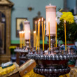 Stock Photo: Prayer candles in a church
