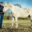 Stock Photo: Mand horse outdoors