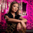 Beautiful young woman posing over luxury interior — Stock Photo