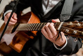 Musician playing a guitar — Stock Photo