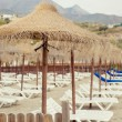 Parasols and empty deckchairs on the Nerja beach. Spain — ストック写真