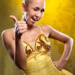 Foto Stock: Smiling ballerinin yellow tutu with thumbs up