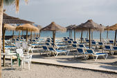 Parasols with deckchairs on the beach. Nerja, Spain — Stock Photo