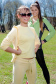Sporty smiling girls posing outdoors — Stock Photo