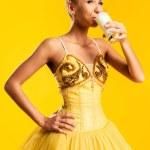Ballerina drinking kefir — Stock Photo