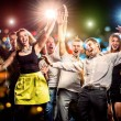Cheerful group of young people dancing at party — Foto de Stock   #40707529