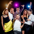 Cheerful group of young people dancing at party — Stock Photo