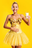 Ballerina with glass of milk or yoghurt — Stock Photo