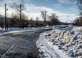 Snowdrifts and rural road. Petropavlovsk-Kamchatsky in march — Foto Stock
