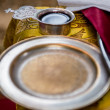 Common cup with red wine, accessories for a  Orthodox wedding — Stock Photo #45772303