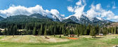 Picturesque landscape with empty playground and High Tatras — Stock Photo