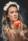 Beautiful seductive woman with apple, conceptual photo — Stock Photo