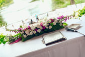 Beautiful bouquet on table for a wedding ceremony — Stock Photo