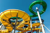 Tube slides at water park against blue sky — Foto Stock