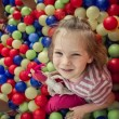 Happy Baby Girl Playing in Plastic Ball Pool — Stock Photo
