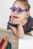 Cute Little Girl with Blue Glasses Painting on a School Desk — Foto de Stock