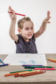 Cute Little Girl Painting on a School Desk — Stock Photo