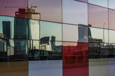 Distorted reflections in the windows of skyscraper — Stock Photo