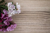Articial Flowers on Wooden Desk  — Stock Photo