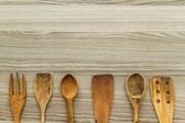 Kitchen wooden utensil of scapula, spoon and fork  — Stock Photo
