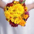 Hands holding an bouquet — Stock Photo