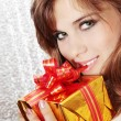 Woman opens a gift — Stock Photo
